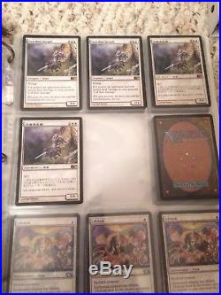 Magic the gathering binders full of cards. Rares, uncommons, commons
